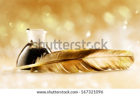 Feather with the bottle full of ink - stock photo