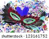 feathers carnival mask and confetti of different colors - stock photo
