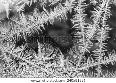 Feathery frost pattern - ice flowers on window glass - stock photo