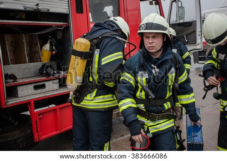 February 29, 2016. Kiev region, Ukraine. Firefighters training. A hundred firefighters put out a conditional fire on storage.