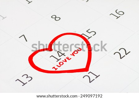 February 14 on the calendar, Valentine's day, heart from red felt - stock photo