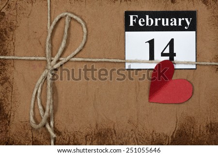 February 14, on the calendar, Valentine's day, heart from red paper - stock photo
