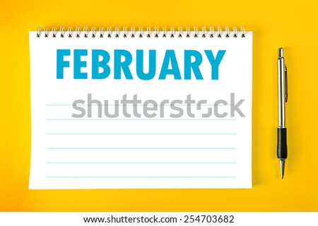 February Paper Calendar Blank Page with Spiral Binding as Time Management and Schedule Concept, top view - stock photo