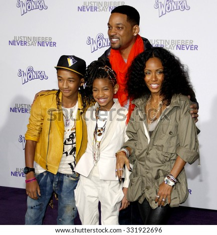 "February 8, 2011. Will Smith, Jada Pinkett Smith, Jaden and Willow Smith at the Los Angeles premiere of ""Justin Bieber: Never Say Never"" held at the Nokia Theatre L.A. Live, Los Angeles.  - stock photo"