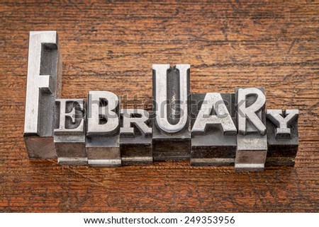 February word in mixed vintage metal type printing blocks over grunge wood - stock photo
