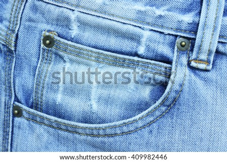 Fed jean on front pocket with a blue tone - stock photo