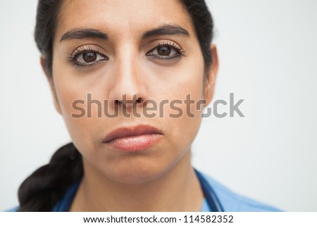 Fed up looking nurse in hospital - stock photo