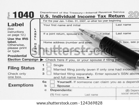 Federal Income Tax Document 1040, with a pen resting on top of the form.