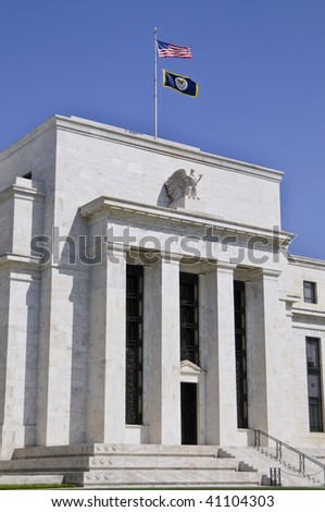 Federal reserve building in washington DC against blue sky - stock photo