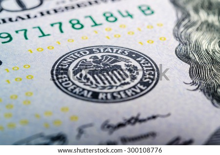 Federal reserve system symbol on hundred dollar bill closeup macro shot - stock photo