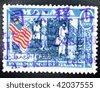 FEDERATION OF MALAYA - CIRCA 1961: A stamp printed in the Federation of Malaya shows image of the Malaysian flag, series, circa 1961 - stock photo