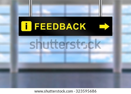 feedback word on airport sign board with blurred background - stock photo
