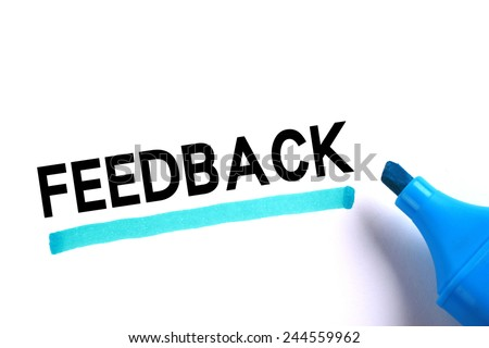 Feedback word with blue marker on white background. - stock photo