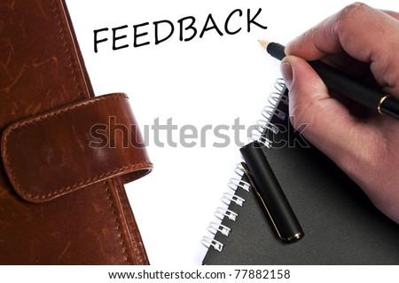Feedback write by male hand - stock photo