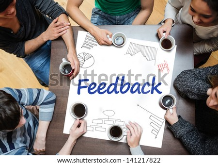 Feedback written on a poster with drawings of charts during a brainstorm - stock photo