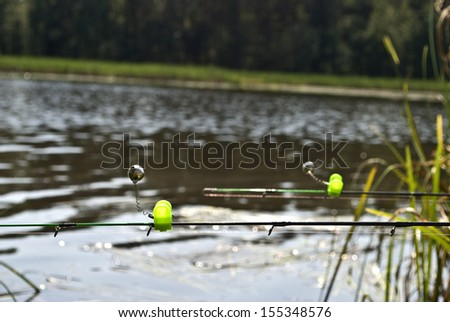 Feeder method in fishing and bells on the rods tips - stock photo