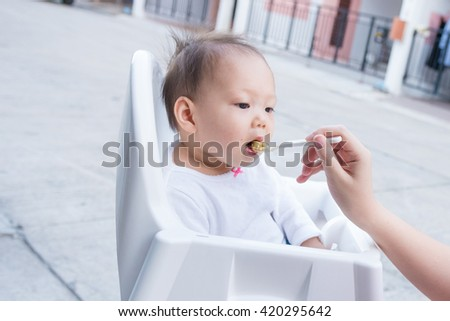 Feeding baby food with a spoon