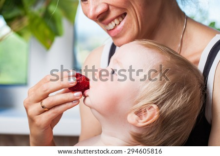 feeding baby strawberries