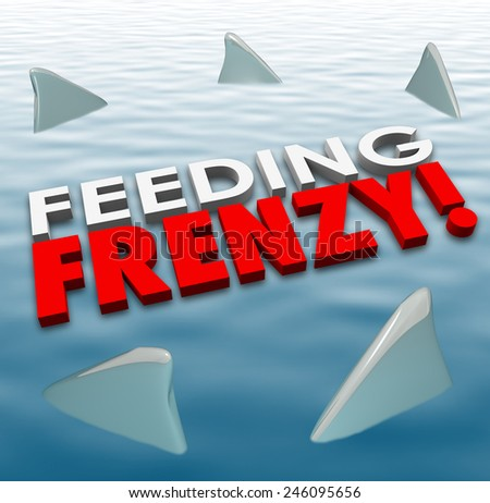 Feeding Frenzy in 3d letters on water surface with shark fins surrounding them to illustrate fierce and deadly competition in a game, career or life - stock photo