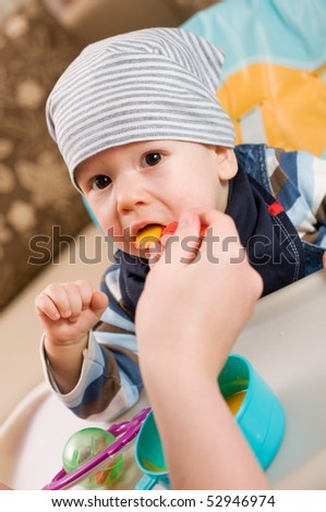 Feeding of a small child - stock photo