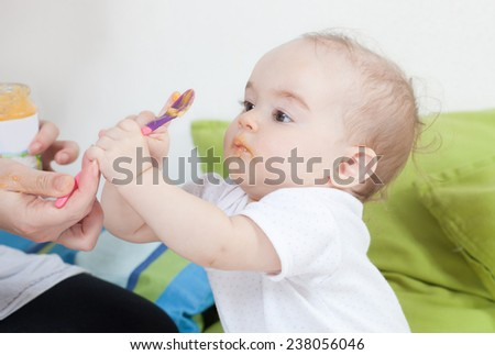 Feeding the baby - stock photo