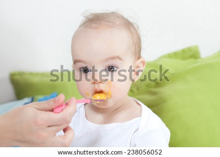 Feeding the baby - stock photo