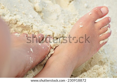 feet buried in the sand