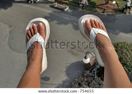Feet dangling from a carnival ride - stock photo