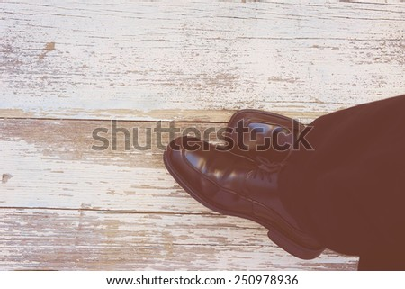 Feet. First-Person view  on rustic wood Floor background.