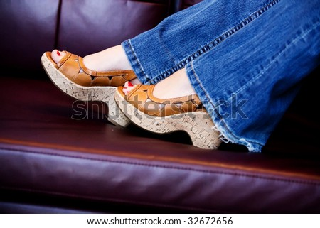 feet in high heel shoes - stock photo