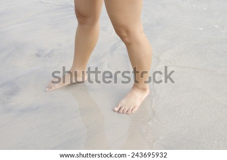 feet in sand - stock photo