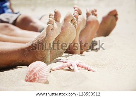 feet in the sand - stock photo