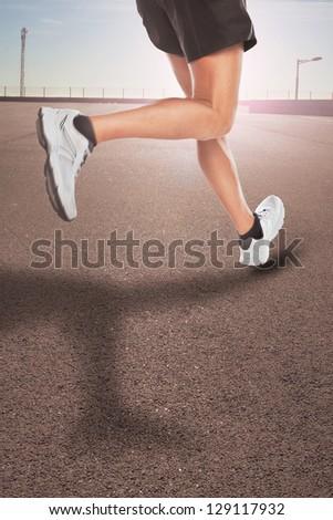 Feet of a marathon runner / Athlete man shoes running in the street - stock photo