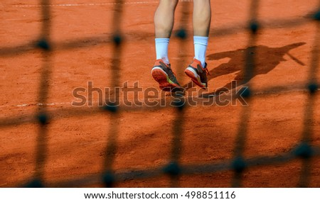 Feet of a tennis player in service motion