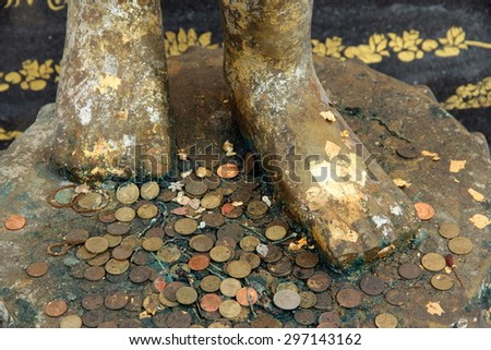 Feet of Buddha Image and Forecast Coins - stock photo