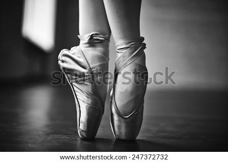 Feet of dancing ballerina during rehearsal - stock photo