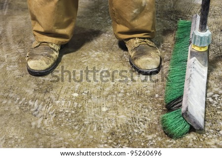 Feet of man in workshop - stock photo
