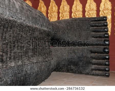 Feet of  Reclining Buddha - stock photo