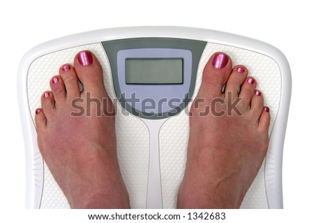 Feet on a bathroom scale. Sceen is blank so you can enter your own numbers or text. Isolated.  Includes clipping path. - stock photo