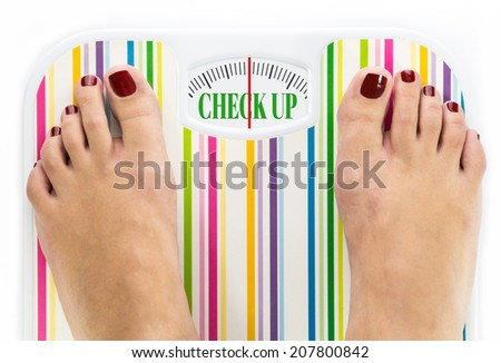 """Feet on bathroom scale with words """"Check up"""" on dial - stock photo"""