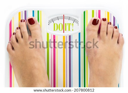 """Feet on bathroom scale with words """"Do it"""" on dial - stock photo"""
