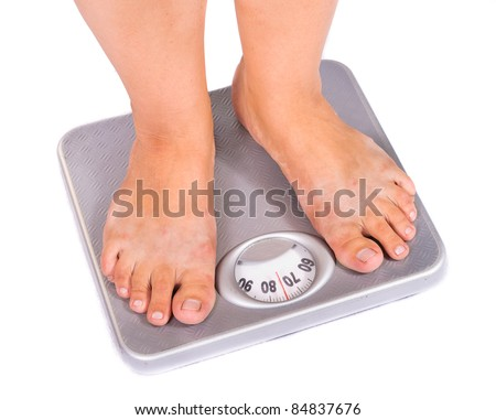 Feet on floor scales. Isolated on white background - stock photo