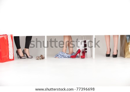 feet on high heels showing from wordrobe - stock photo