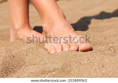 Feet on sand - stock photo