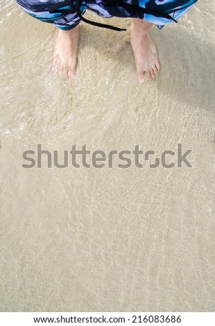 Feet on the beach - stock photo