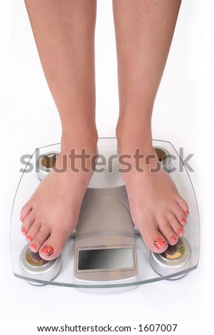 feet on white scale close up - stock photo