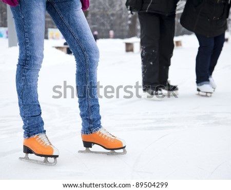Feet skater standing on the ice - stock photo