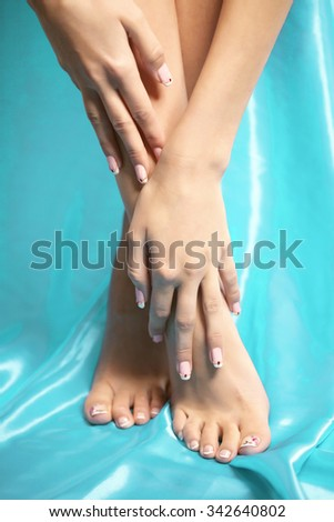 Feet spa, legs foot massage in spa. Woman feet care. Legs stockings, tights Beautiful manicured feet with a neat pedicure - stock photo