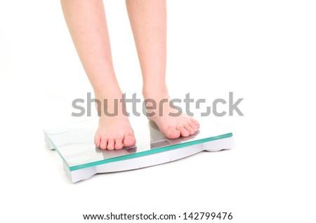 feet standing on bathroom scale - stock photo