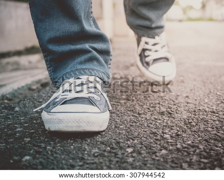 Feet Walking (Vintage Style)  - stock photo
